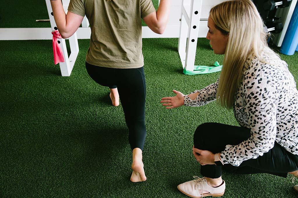 Woman lifting heels of feet